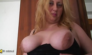 Chubby giant breasted mama playing with a fucktoy